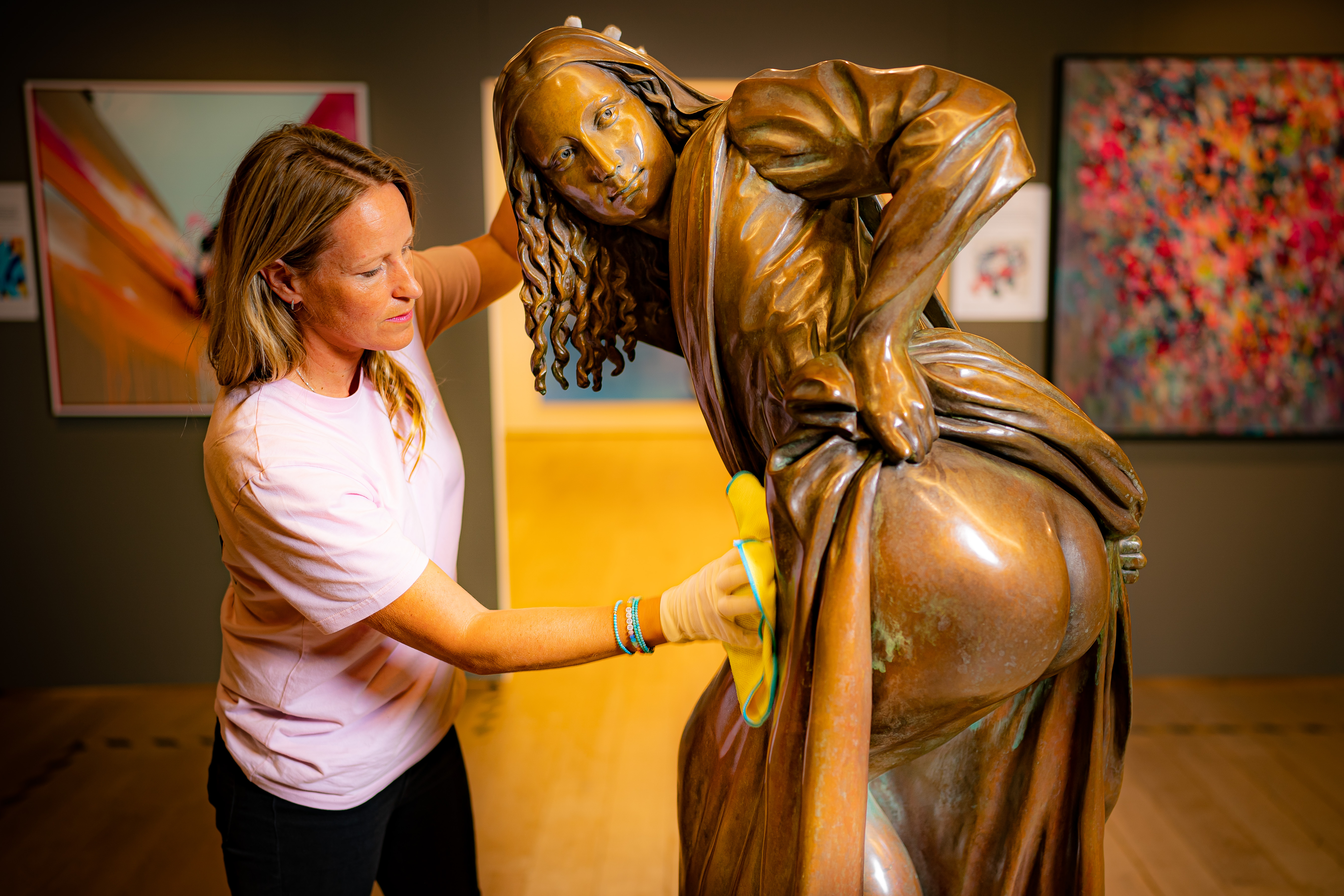 <p>Vanguard exhibition director, Mary McCarthy, makes final inspections on the life-size bronze artwork by Bristol street artist Nick Walker, titled 'Moona Lisa', which is going on show for the first time at M Shed, Bristol. The bronze statue, weighing 260kg, has been installed in the exhibition, exploring the instrumental role Bristolian artists have played in the development of British street art. Picture date: Monday September 13, 2021.</p>