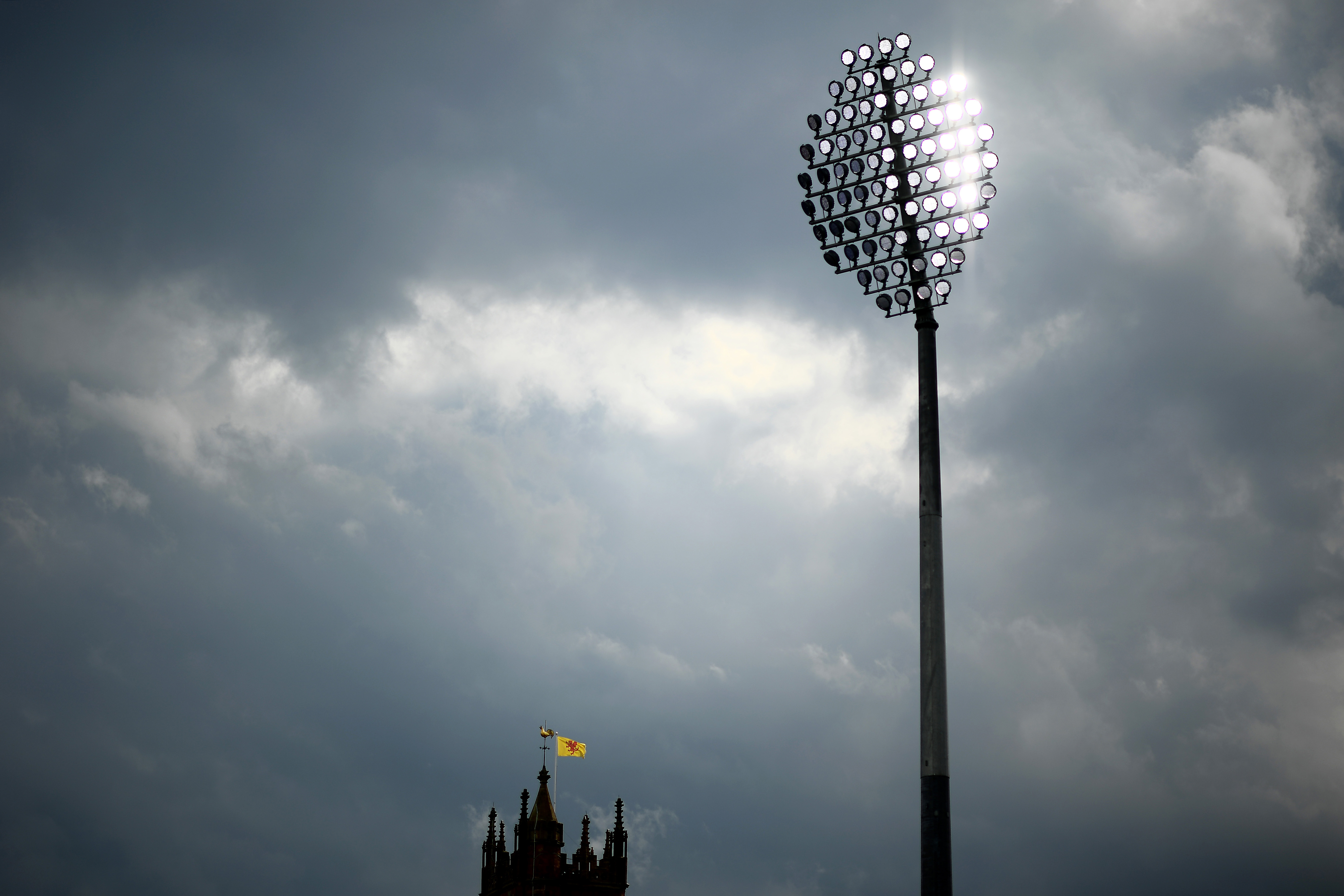 <p>TAUNTON, ENGLAND - SEPTEMBER 13: A Somerset flag flies from a nearby church as the floodlights are turned on during Day Two of the LV= Insurance County Championship match between Somerset and Lancashire at The Cooper Associates County Ground on September 13, 2021 in Taunton, England. (Photo by Harry Trump/Getty Images)</p>