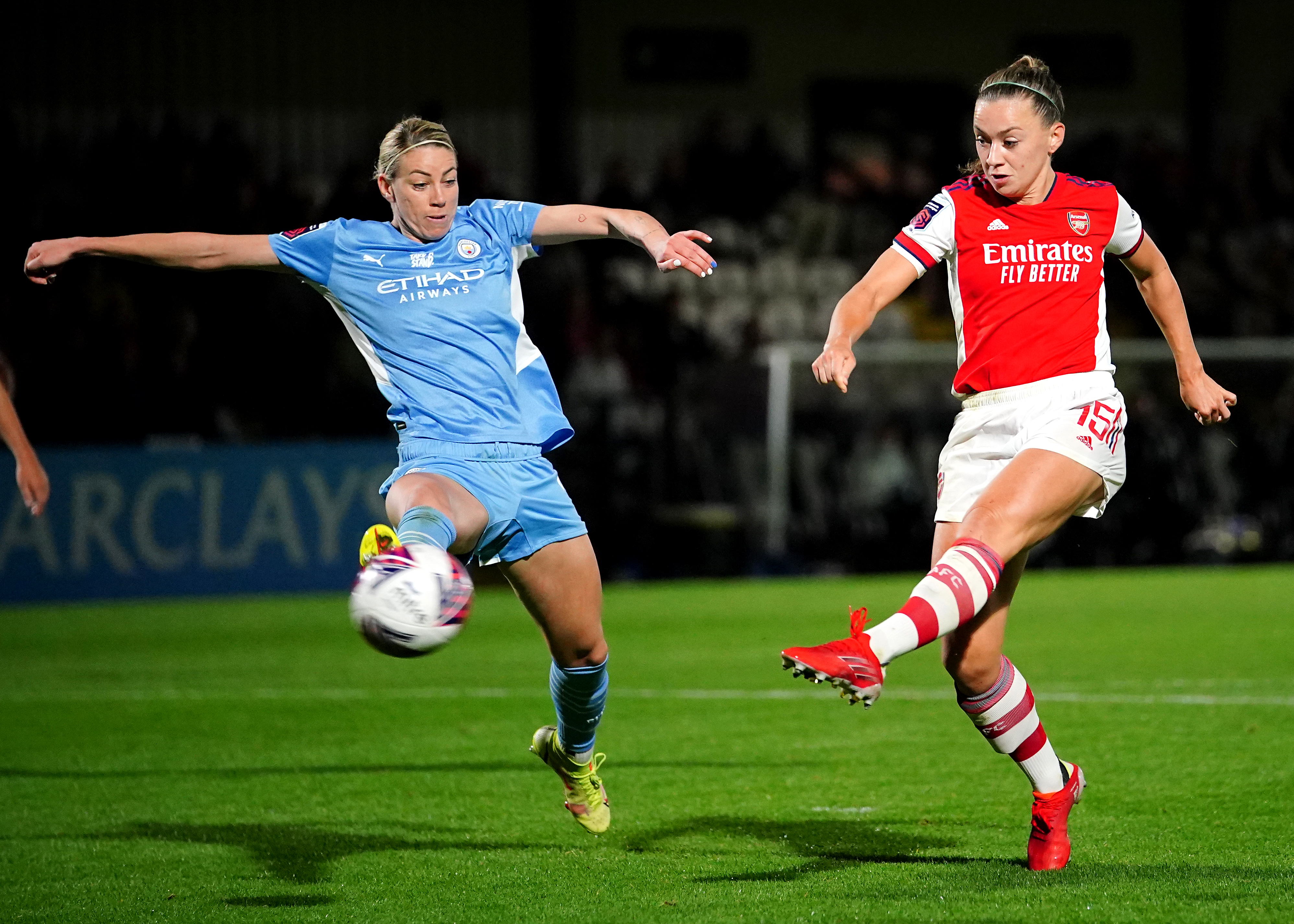 <p>Arsenal's Katie McCabe (right) celebrates scoring their side's third goal of the game during the FA Women's Super League match at Meadow Park, Borehamwood. Picture date: Sunday September 26, 2021.</p>