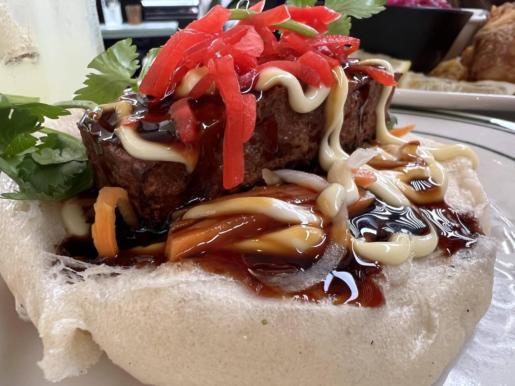 <p>iPhone 13 Pro camera sample: Mayonnaise, cilantro, sweet dark sauce dripping down a piece of blackened tofu on a white bun.</p>