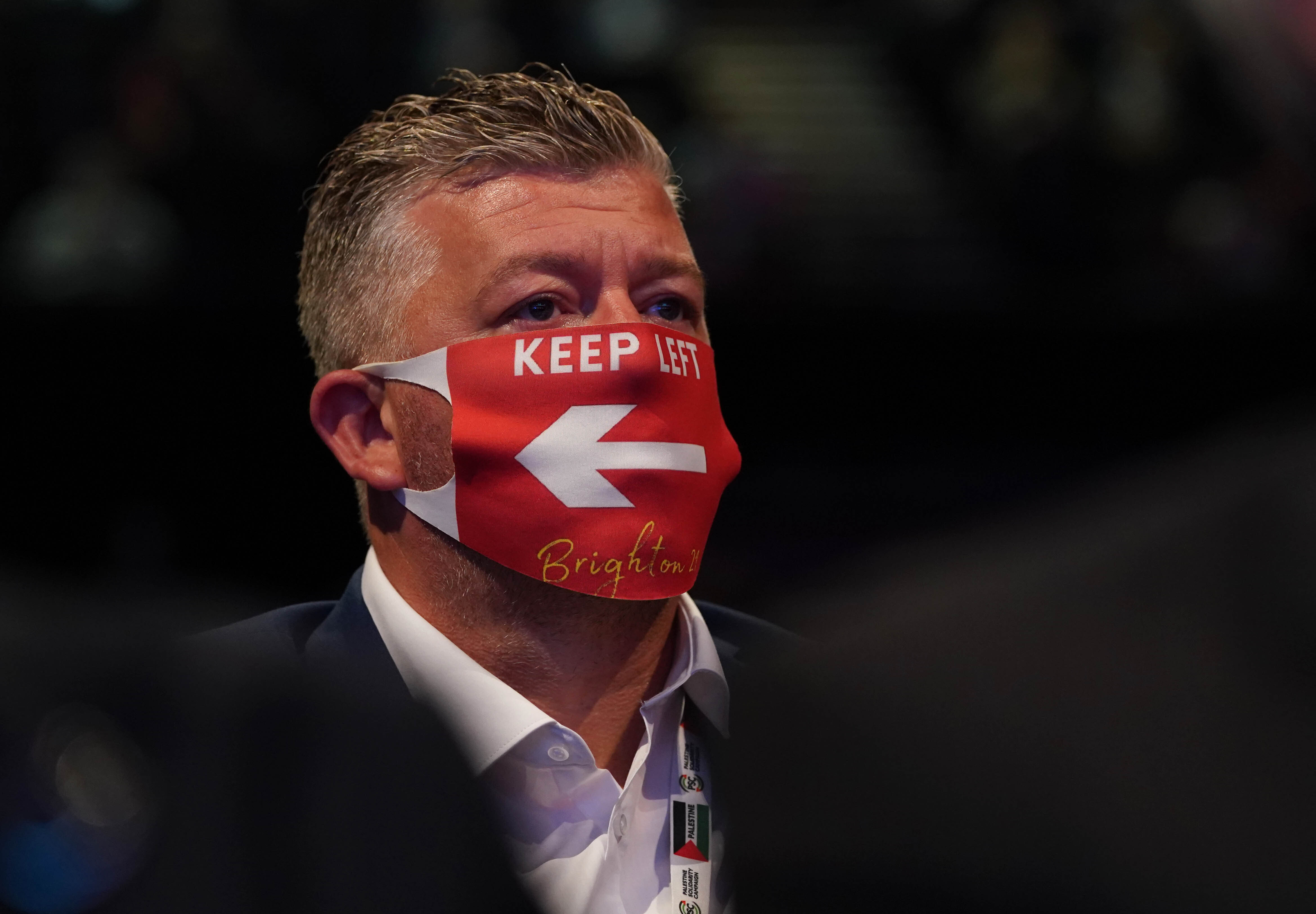 <p>A delegate in the audience listens to speeches at the Labour Party conference in Brighton. Picture date: Tuesday September 28, 2021.</p>