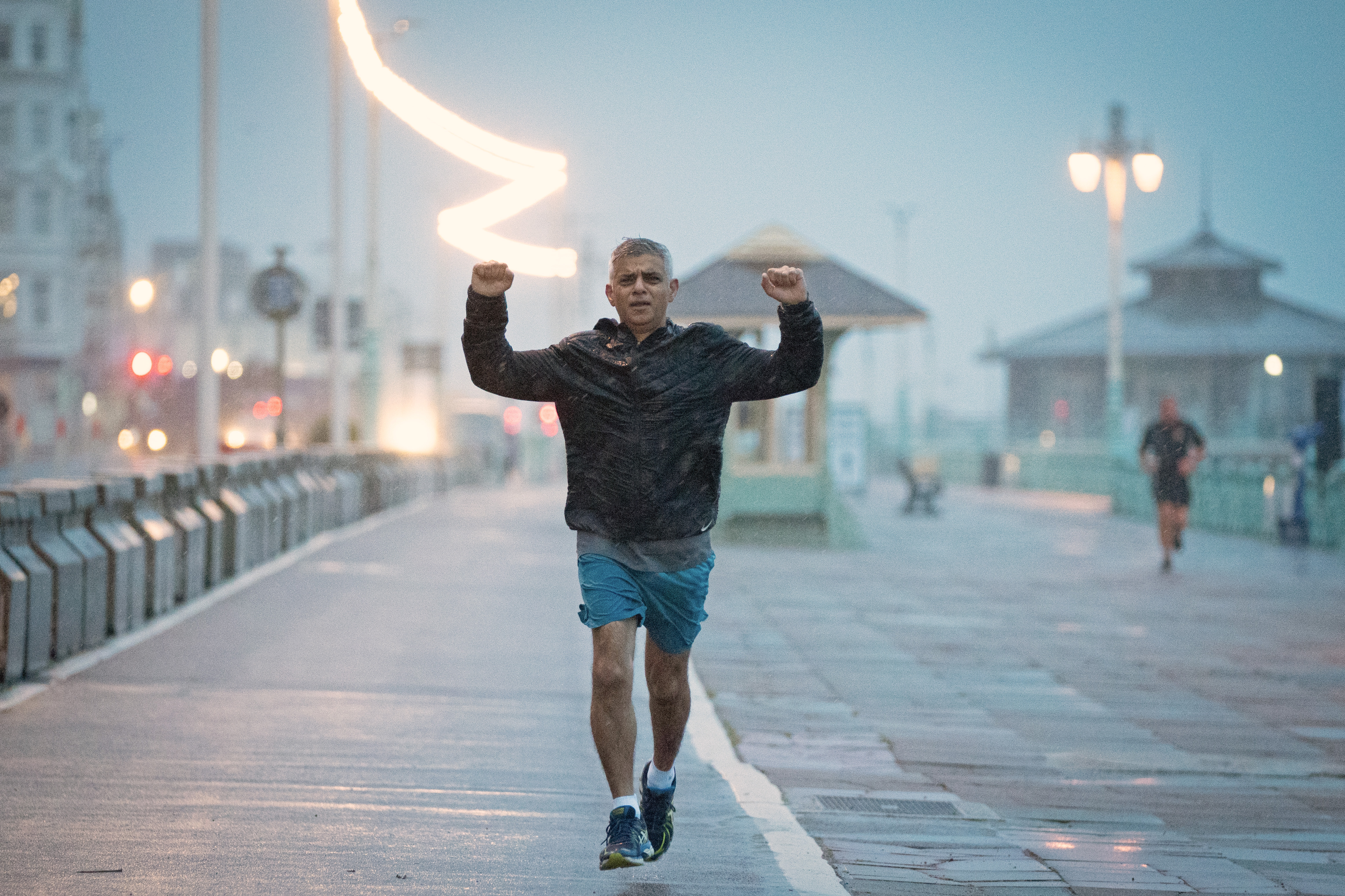 <p>Mayor of London Sadiq Khan runs along the seafront in Brighton where the Labour Party is holding its Conference. Picture date: Monday September 27, 2021.</p>