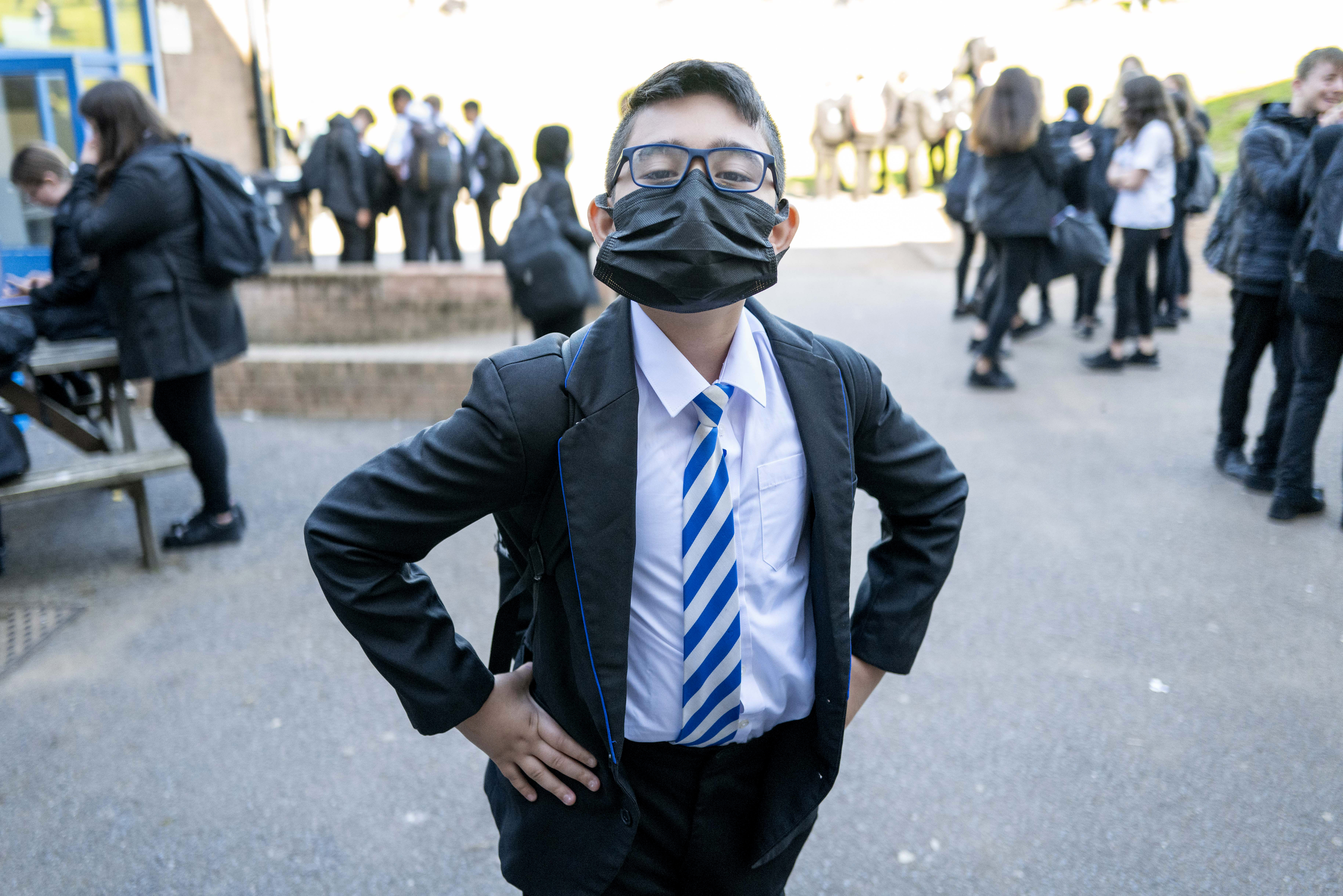 <p>CARDIFF, WALES - SEPTEMBER 20: A child wearing a face mask poses for a photograph at Llanishen High School on September 20, 2021 in Cardiff, Wales. All children aged 12 to 15 across the UK will be offered a dose of the Pfizer-BioNTech Covid-19 vaccine. Parental consent will be sought for the schools-based vaccination programme. (Photo by Matthew Horwood/Getty Images)</p>