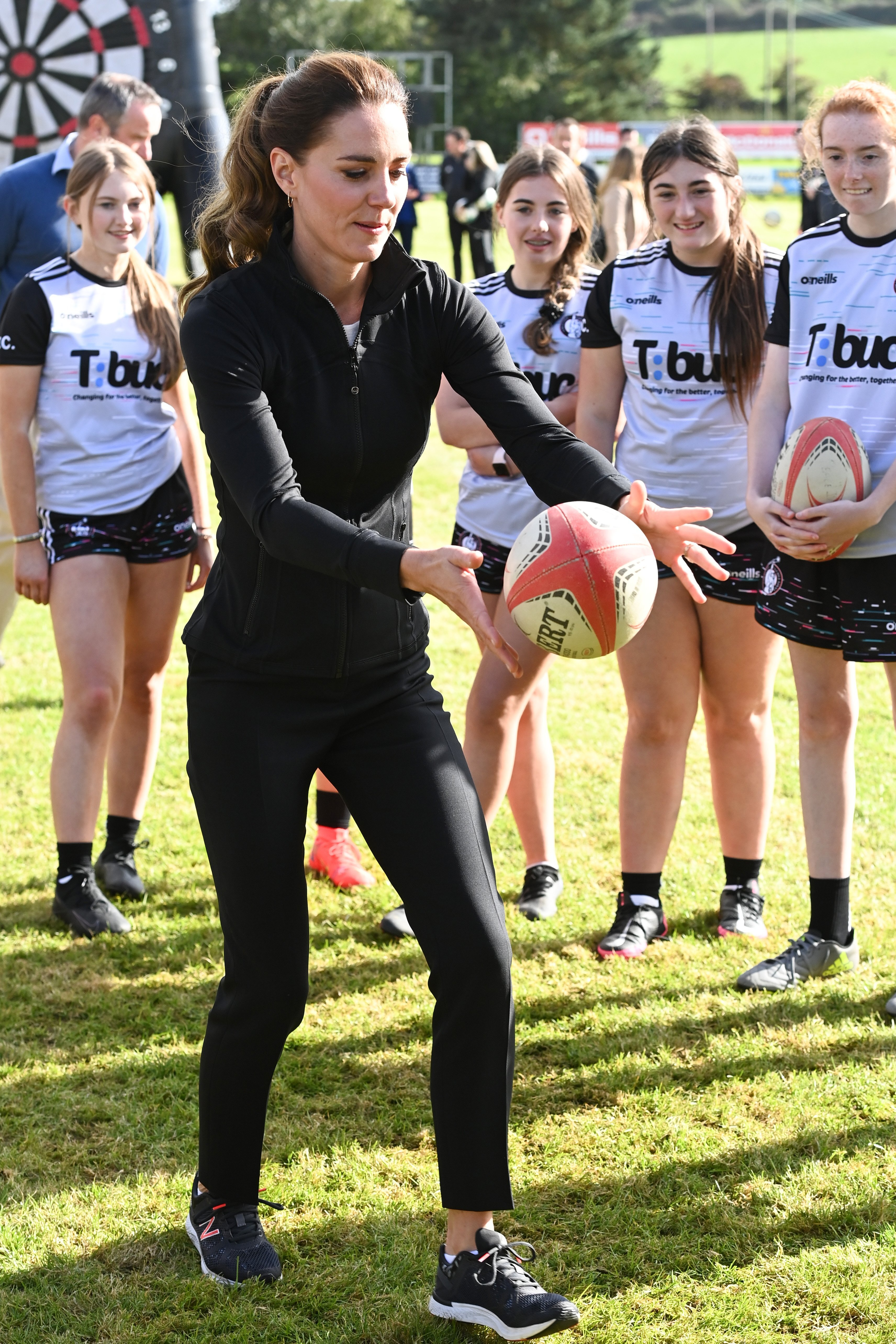 <p>The Duchess of Cambridge kicks a rugby ball during a visit to the City of Derry rugby club in Londonderry, to participate in a sports initiative bringing football, rugby and GAA playing children, together. Picture date: Wednesday September 29, 2021.</p>