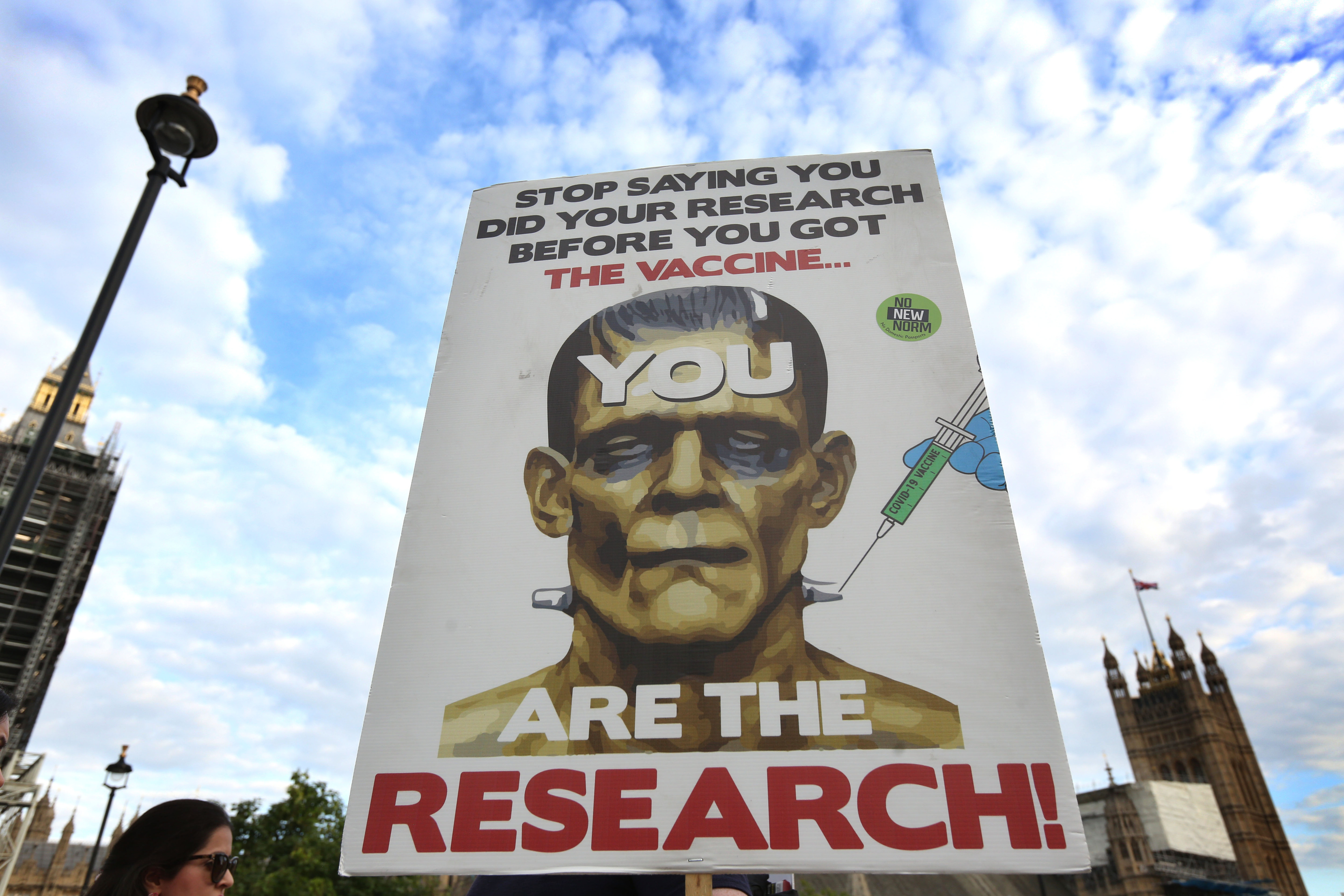 <p>LONDON, UNITED KINGDOM - 2021/09/18: A protester holds a placard as protesters march from Regent's Park to Downing Street at the World Wide Rally for Freedom. They march for their children and against child vaccination, Vaccine passports and future lockdowns. (Photo by Martin Pope/SOPA Images/LightRocket via Getty Images)</p>