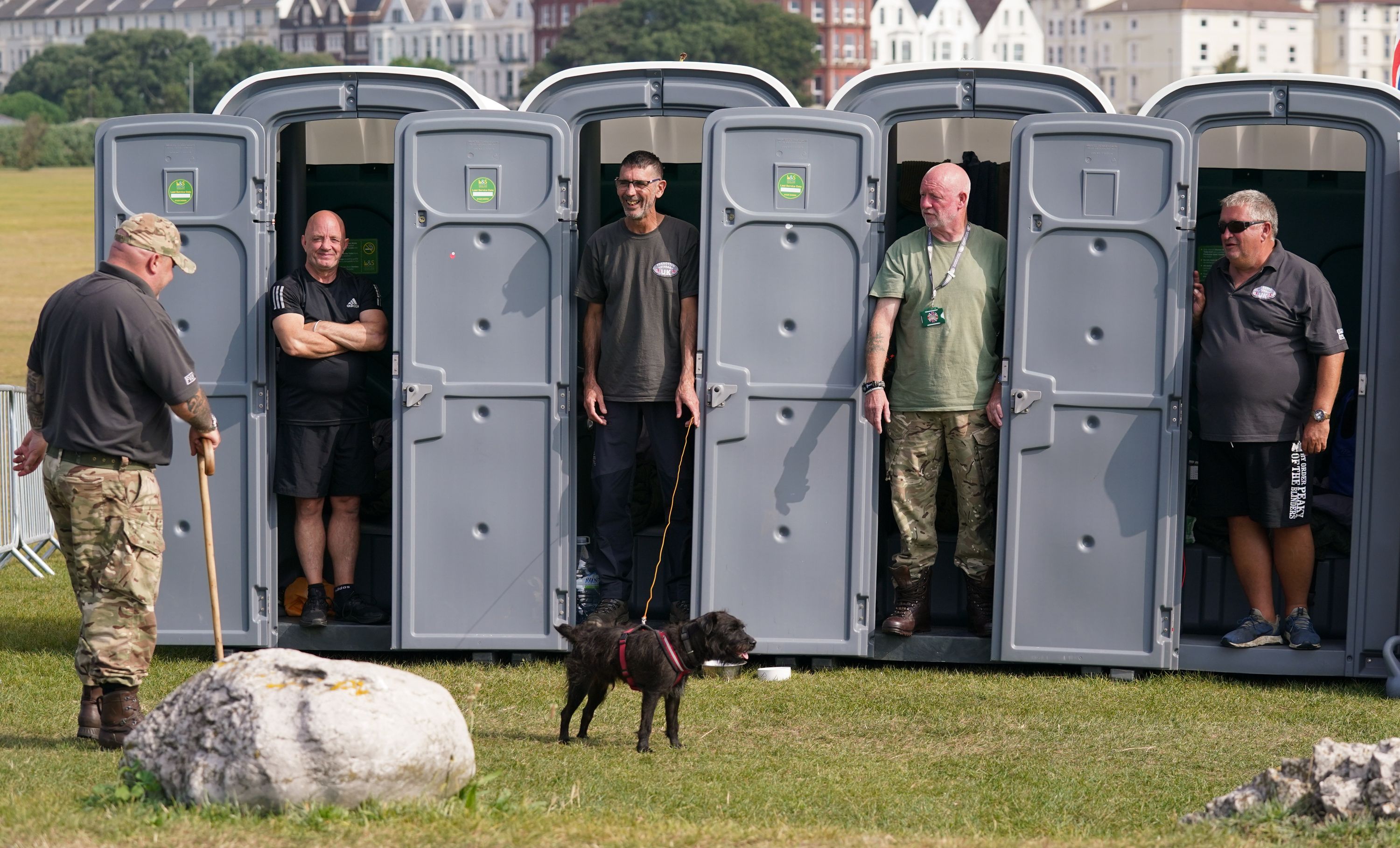 <p>Forgotten Veterans UK founder Gary Weaving (far left) chats with veterans (from 2nd left to right) Ian Baillie, Mike Hewlett, Gary Sprakes and Chris Nicholls, who are spending 120 hours in portable toilet cabins on Southsea Common in Portsmouth, Hampshire, to raise money for Forgotten Veterans UK which supports former members of the armed forces. The Veterans from the Army and the Royal Navy Submarine service, who are aiming to raise �1,500, began their sit-in on Wednesday and will finish at 4pm on Sunday. Picture date: Thursday September 16, 2021.</p>