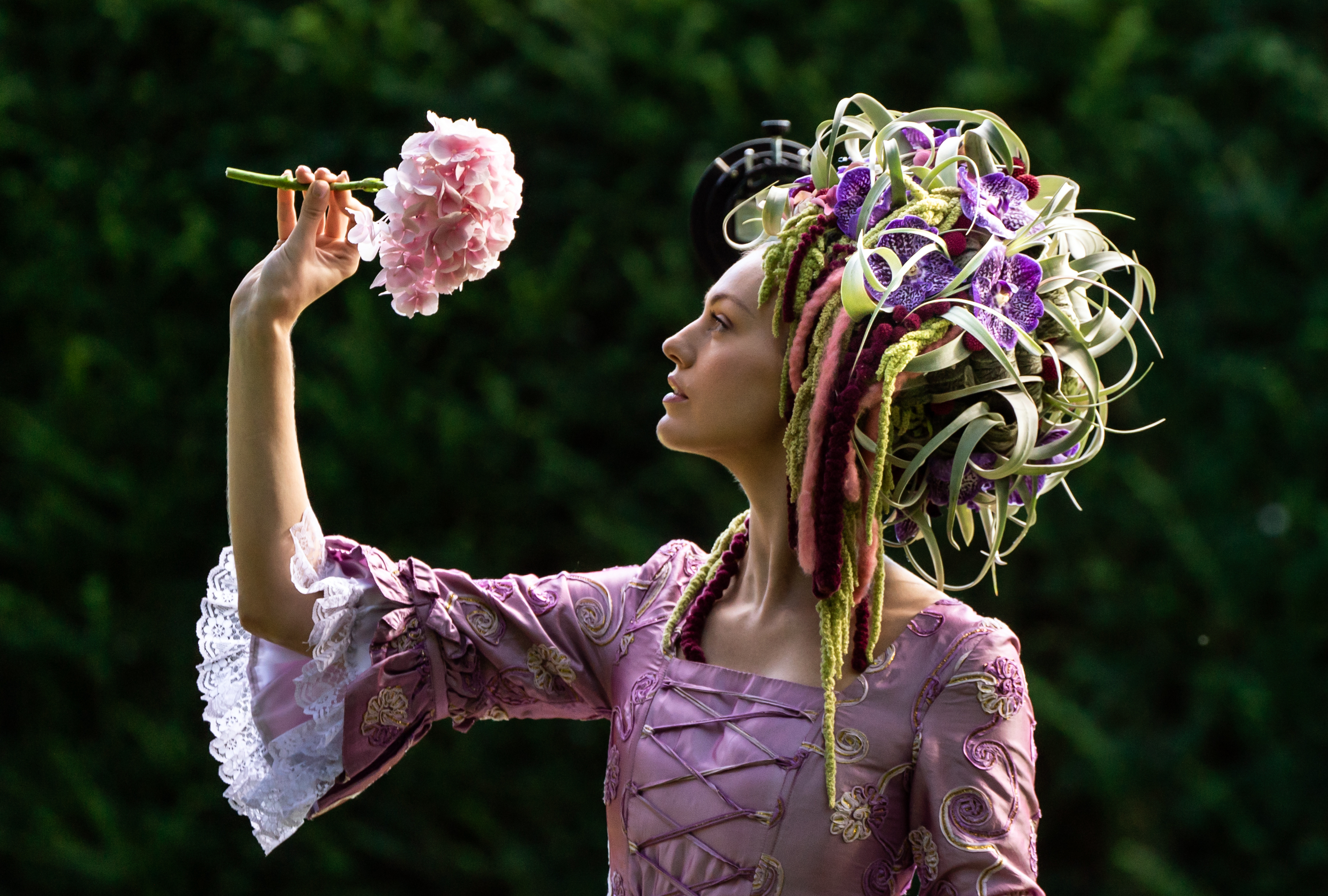 <p>Gemma Sadler models a fabulous Georgian costume, including a wig made from flowers and foliage created by Florist of the Year Helen James, during the staging day for the 2021 Harrogate Autumn Flower Show at Newby Hall, near Ripon. Picture date: Thursday September 16, 2021.</p>