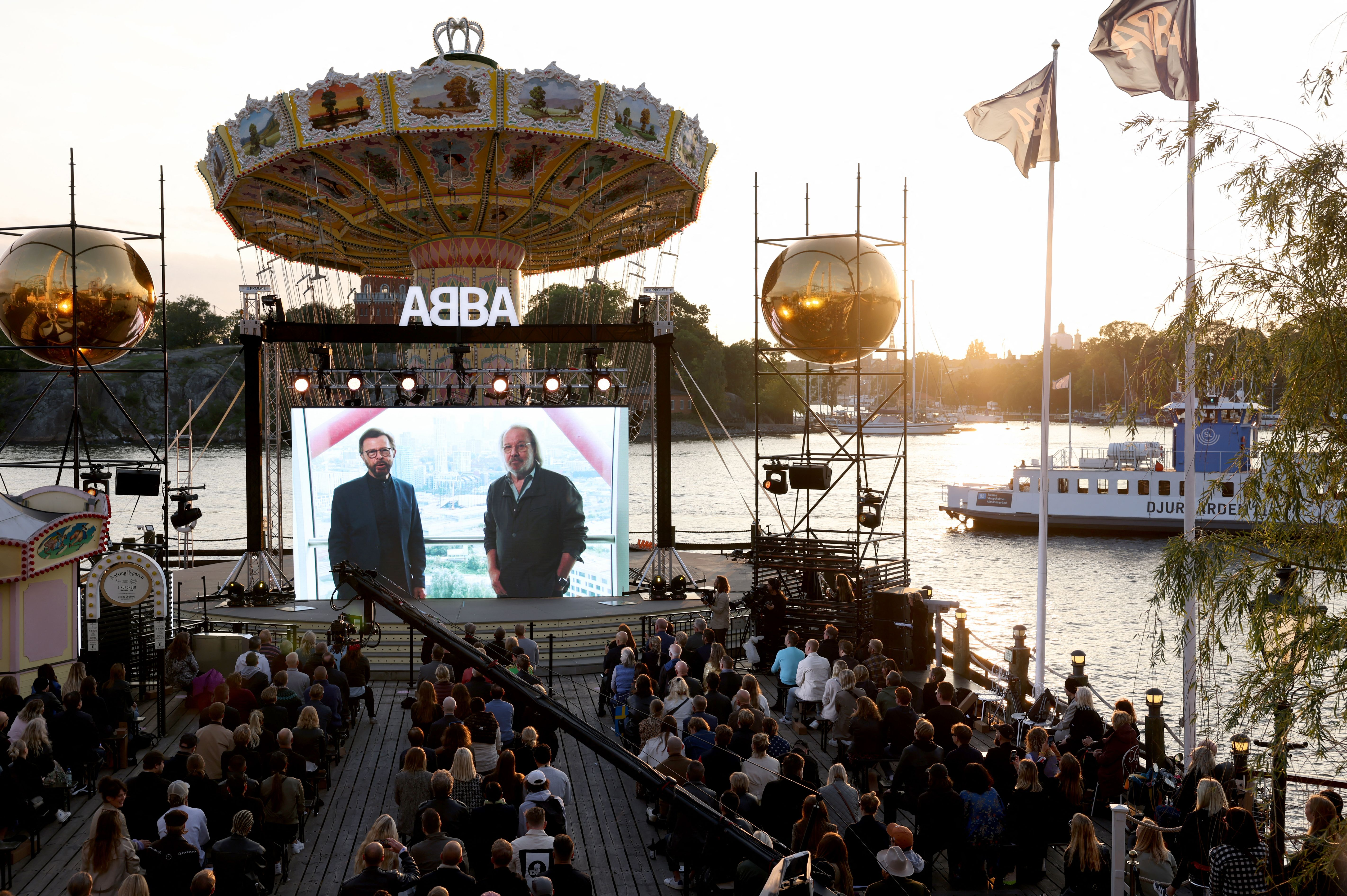 <p>Members of the Swedish group ABBA Bjoern Ulvaeus and Benny Andersson are seen live on a display from London during their Voyage event at Grona Lund, Stockholm, on September 2, 2021, during a livestreamed interview on their first album after nearly four decades. - Sweden OUT (Photo by Fredrik PERSSON / TT News Agency / AFP) / Sweden OUT (Photo by FREDRIK PERSSON/TT News Agency/AFP via Getty Images)</p>
