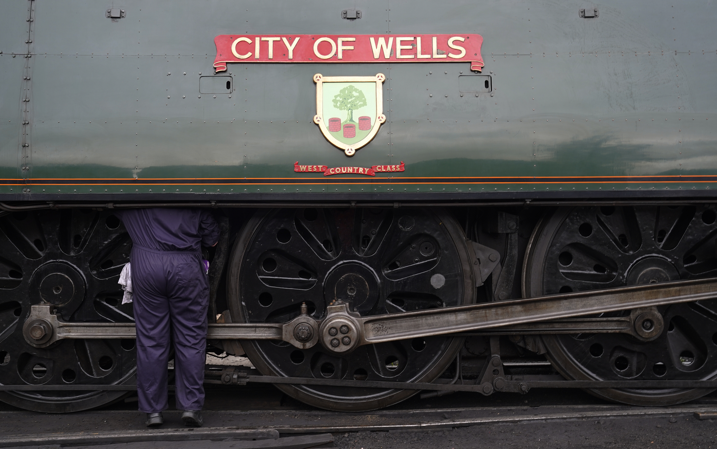 <p>Volunteer Dave Driver works on the steam locomotive 34092 'City of Wells' at Ropley yard on the Mid Hants Railway, also known as the Watercress line, a 19th-century steam train heritage line in Hampshire, ahead of their Autumn Steam Gala which runs from October 1-3. The City of Wells is one of a number of guest locomotives for this year's Autumn Steam Gala, which in partnership with the Somerset and Dorset Railway trust, is recreating the Somerset and Dorset railway from the 1950's and 60's. Picture date: Thursday September 30, 2021.</p>