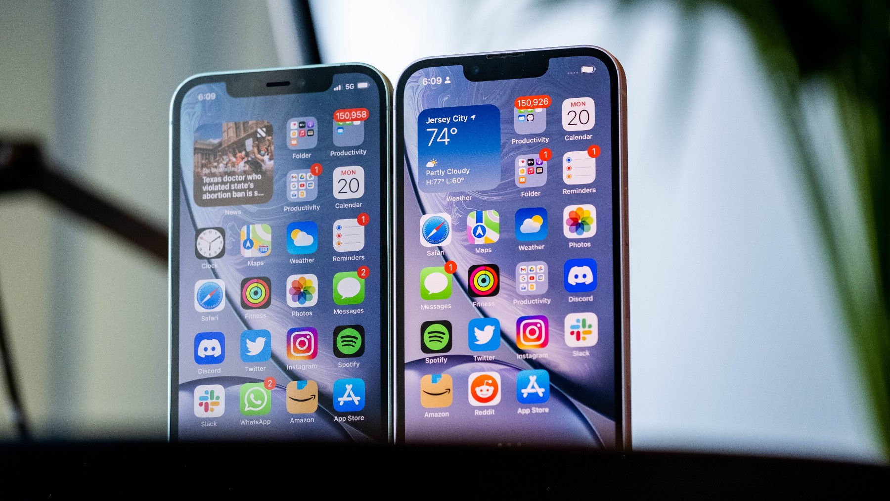 An iPhone 12 and iPhone 13 next to each other with their screens facing the camera.