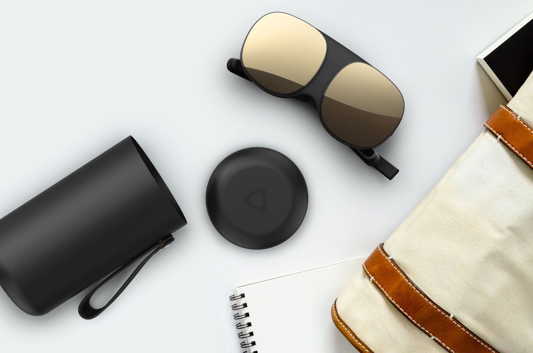 Image of the HTC Flow and its hard carrying case
