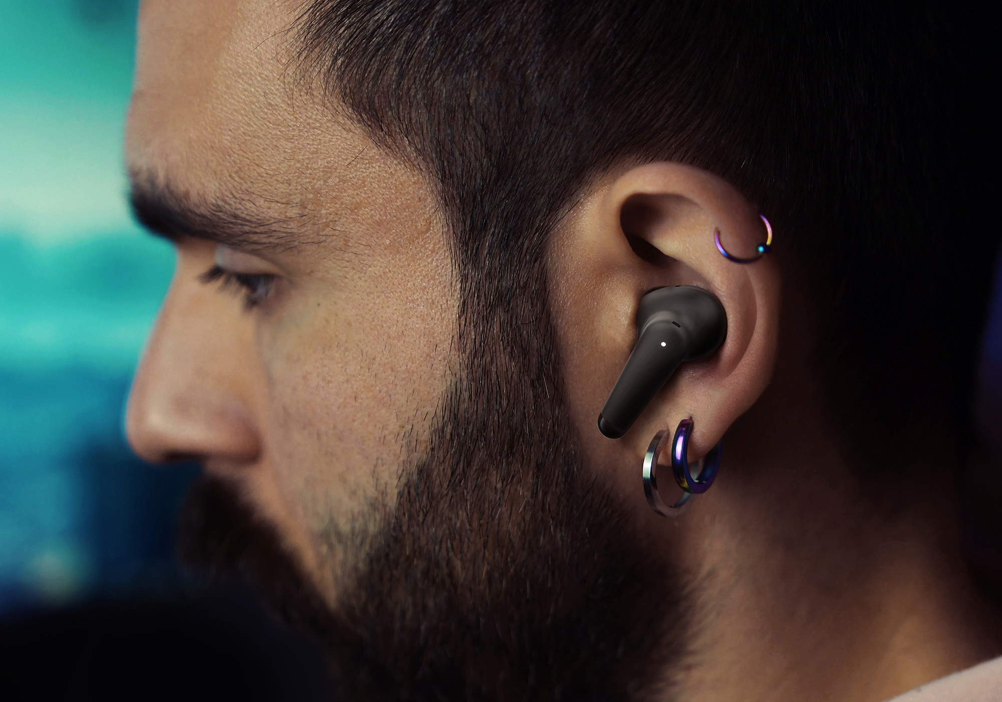 A person wearing a Palm Buds Pro earbud.