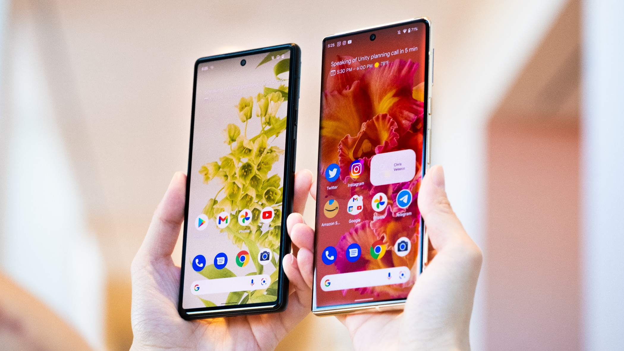 The Google Pixel 6 and 6 Pro held in mid-air with their screens facing the camera.