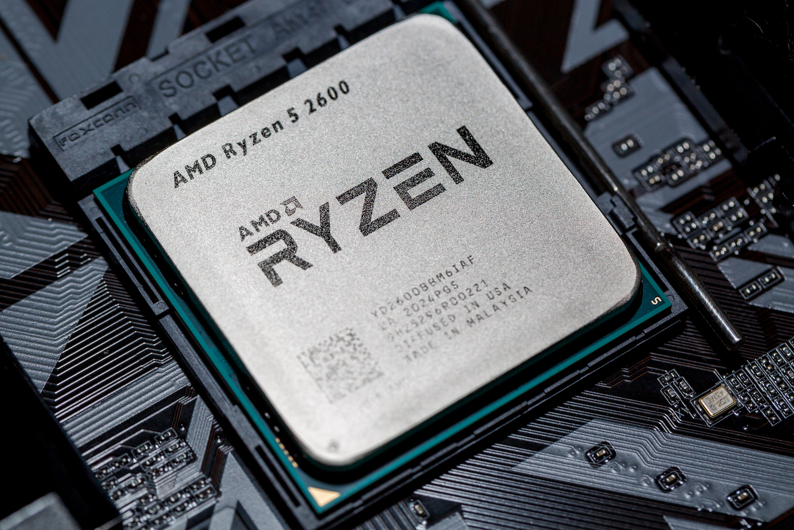 Moscow, Russia - October, 2020: AMD Ryzen 5 2600 Processor close up in the black motherboard CPU socket. Advanced Micro Devices is an American semiconductor company based in Santa Clara, California.