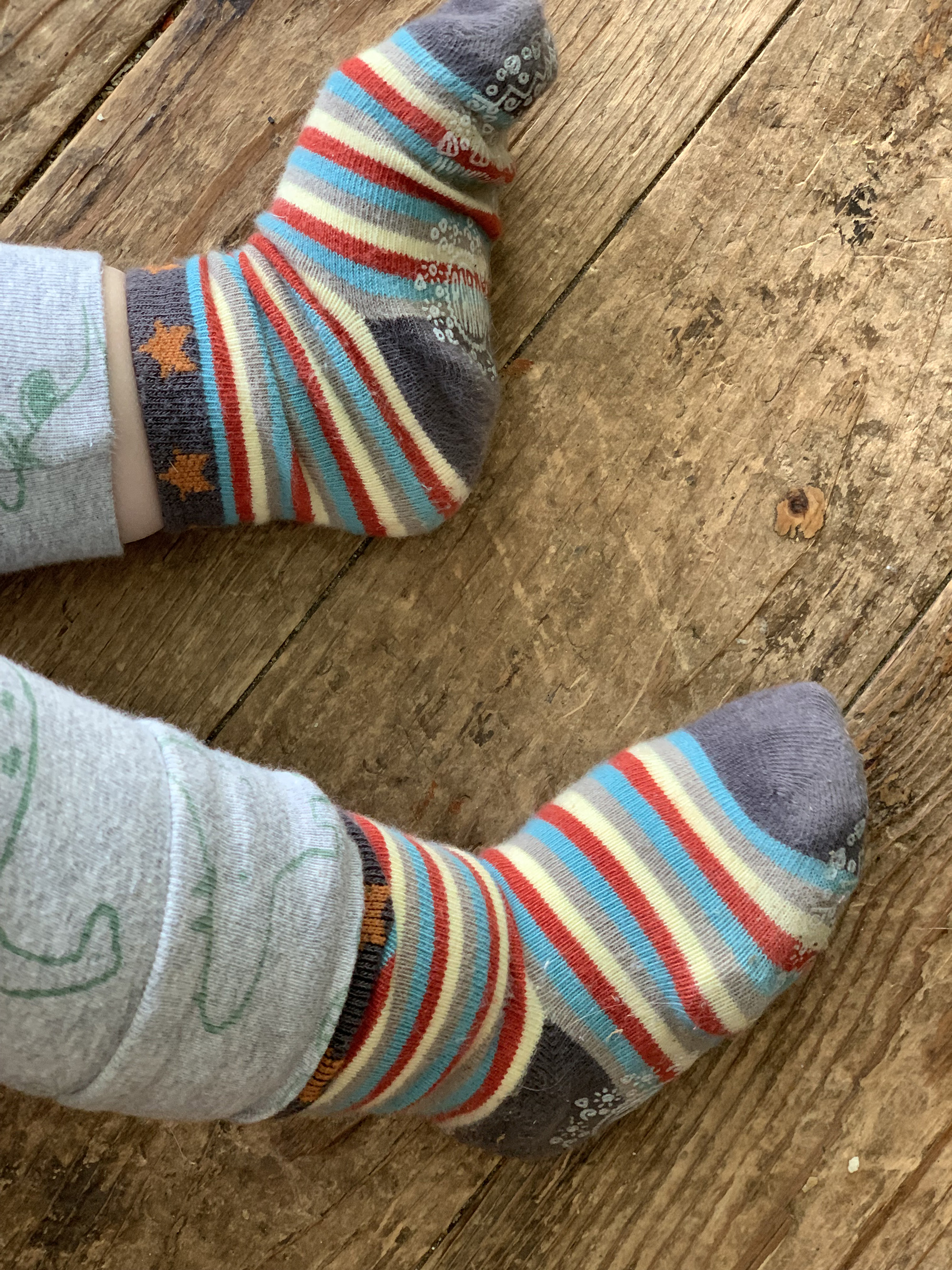 Owlet Smart Sock Plus worn underneath a fabric sock