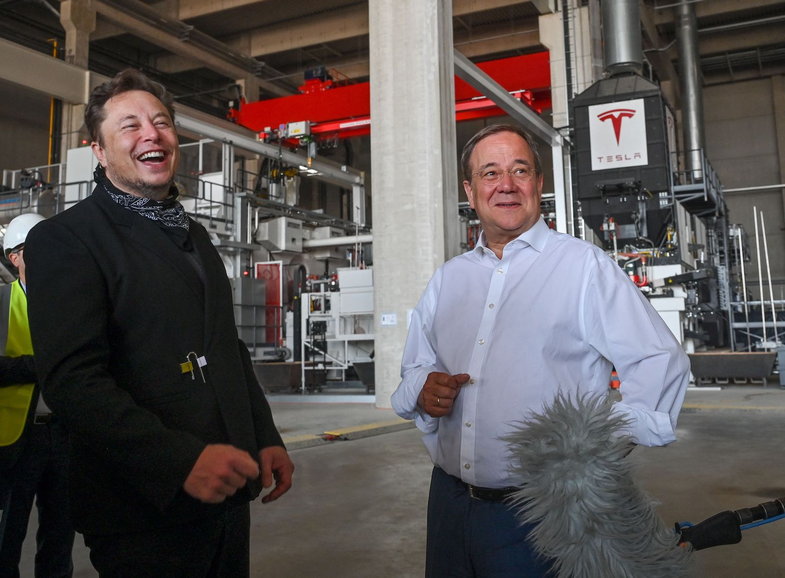 North Rhine-Westphalia's State Premier, Christian Democratic Union (CDU) leader and candidate for Chancellor Armin Laschet (R) and US entrepreneur and business magnate Elon Musk visit the future foundry of the Tesla Gigafactory plant under construction, on August 13, 2021 in Gruenheide near Berlin, eastern Germany. (Photo by Patrick Pleul / POOL / AFP) (Photo by PATRICK PLEUL/POOL/AFP via Getty Images)