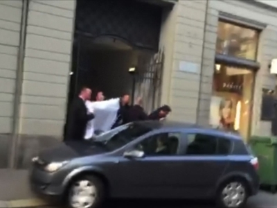 Raw: Man Escorted by Police Amid FIFA Probe