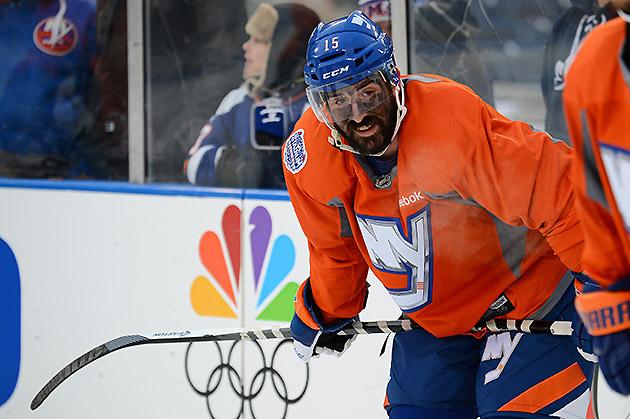 Cal Clutterbuck has a black face during Islanders Yankee Stadium ...