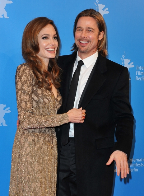 Angelina Jolie and Brad Pitt smile at the 'In The Land Of Blood And Honey' Premiere at the Haus der Berliner Festspiele in Berlin, Germany, on February 11, 2012 -- Getty Images
