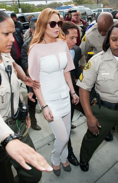 Lindsay Lohan arrives to her trial for allegedly lying to police after a car crash, reckless driving and violating her probation for a 2011 jewelry theft conviction at Airport Branch Courthouse of Los Angeles Superior Court March 18, 2013 in Los Angeles -- Getty Images