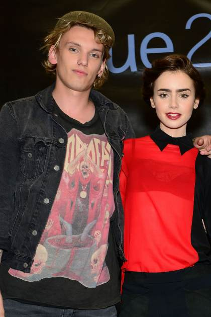 Jamie Campbell Bower and Lily Collins appear at the Franklin Mills Mall in anticipation for Screen Gems action-fantasy 'The Mortal Instruments: City of Bones' on August 2, 2013 in Philadelphia -- Getty Images