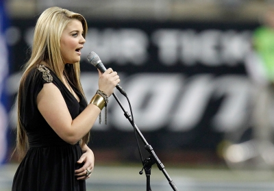 Lauren Alaina performs the National Anthem before the Green Bay Packers take on the Detroit Lions during the Thanksgiving Day game at Ford Field, Detroit, November 24, 2011 -- Getty Images