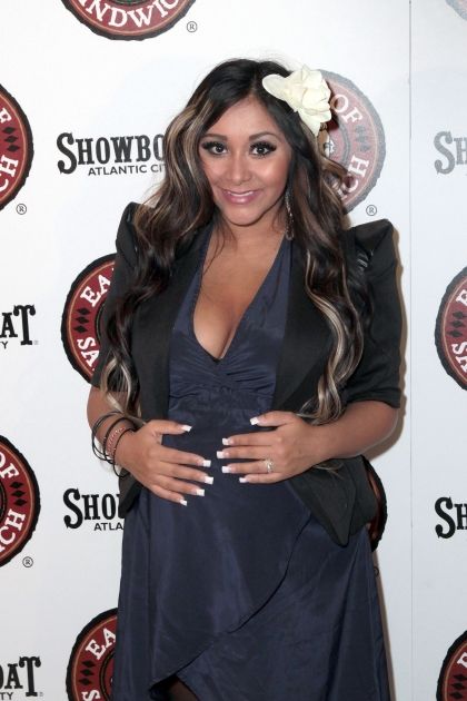 Nicole 'Snookie' Polizzi shows off her baby bump at the Earl of Sandwich Showboat Casino Grand Opening ribbon cutting ceremony in Atlantic City, New Jersey on July 25, 2012 -- Getty Premium