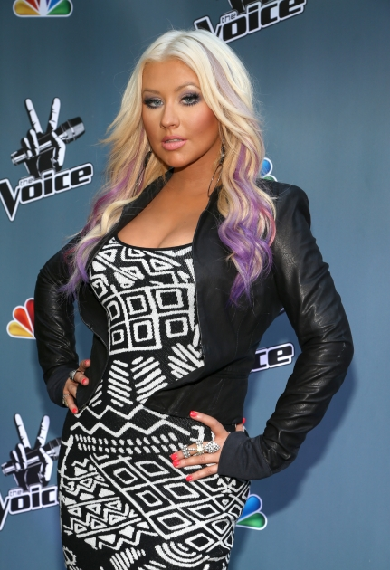 Christina Aguilera attends the NBC Universal's 'The Voice' press junket and cocktail reception in Los Angeles on August 12, 2012 -- Getty Images