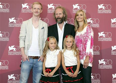 """Director Groning poses with actors Zimmerschied, Finder, Pia Kleemann and Chiara Kleemann during a photocall for the movie """"The Police Officer's Wife"""" during the 70th Venice Film Festival in Venice"""