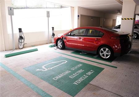 An electric car charges as part of the Drive Electric Orlando program in the parking garage of the Peabody Orlando Hotel