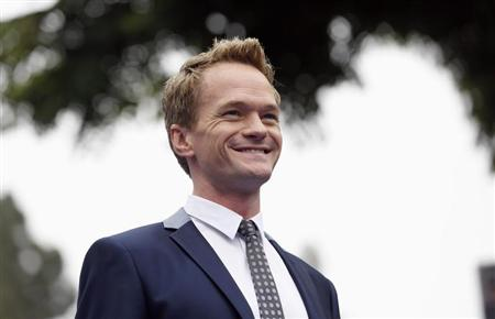 """Cast member Neil Patrick Harris poses at the premiere of the film """"The Smurfs 2"""" at the Regency Village theatre in Los Angeles"""