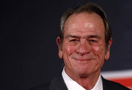 "Cast member Tommy Lee Jones poses for photos during the Japan premiere of his movie ""Emperor"" in Tokyo"