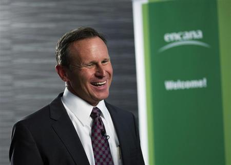 Suttles of EnCana laughs as he speaks to the media after company announced him as the new president and CEO in Calgary