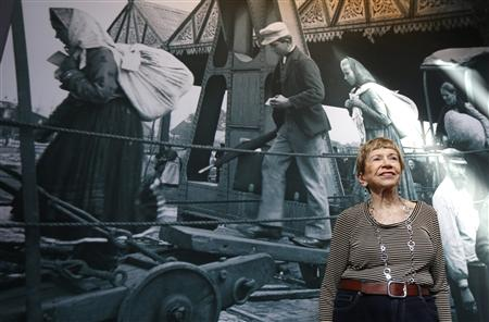 """U.S. author Fuentes from Sarasota, Florida, smiles while visiting the """"Millions of People, One Dream"""" exhibition at the Red Star Line Museum in Antwerp"""