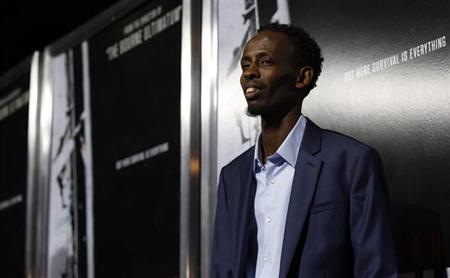 """Cast member Barkhad Abdi poses at the premiere of """"Captain Phillips"""" at the Academy of Motion Picture Arts and Sciences in Beverly Hills, California September 30, 2013. REUTERS/Mario Anzuoni"""