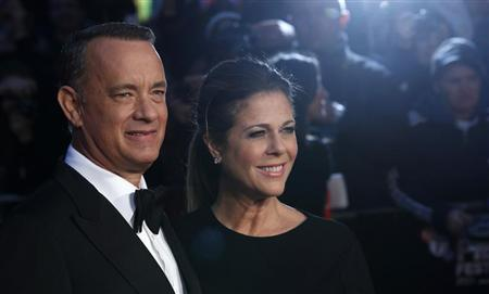 "Tom Hanks and his wife Rita Wilson arrive for the European premiere of ""Captain Phillips"" in London"
