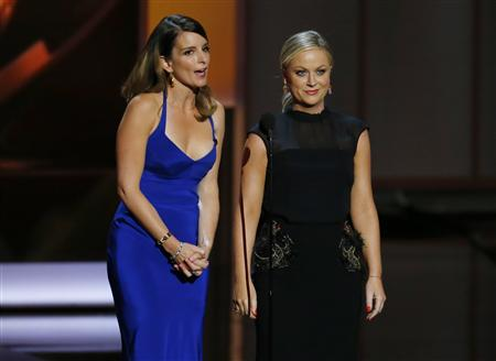File of actresses Fey and Poehler presenting the award for Outstanding Supporting Actress In A Comedy Series at the 65th Primetime Emmy Awards in Los Angeles