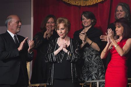 Comedian and actress Burnett is applauded by her husband and members of her private box as she arrives to be feted during the presentation of the Mark Twain Prize for American Humor in Washington