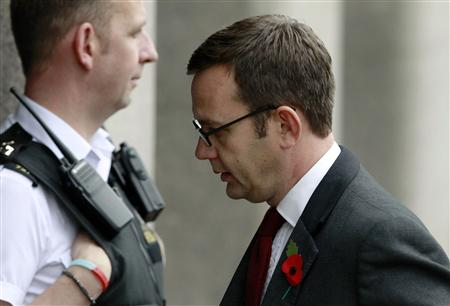 Former News of the World editor Coulson returns to court after a lunch recess at the Old Bailey courthouse in London