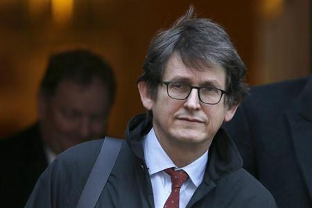 The editor of The Guardian Rusbridger leaves Downing Street in London
