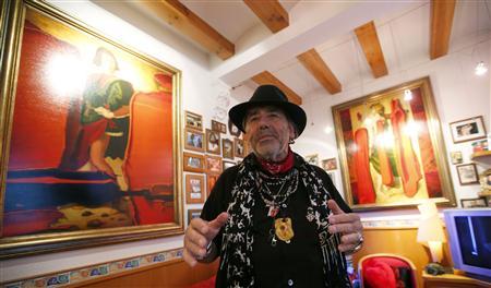 German Ekkeheart Gurlitt, cousin of art hoarder Cornelius Gurlitt, gestures during an interview in Barcelona