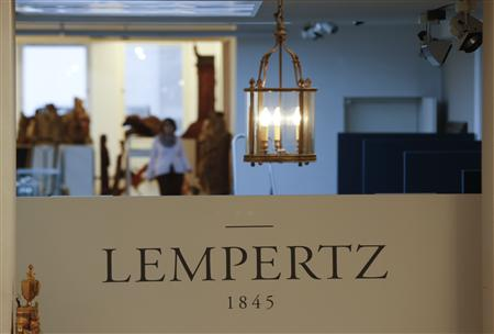 File photo of a lamp hanging over the logo of Cologne's auction house Lampertz