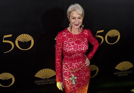 British actress Mirren poses on the red carpet as she arrives at an event celebrating the 50th anniversary of the Mandarin Oriental hotel in Hong Kong