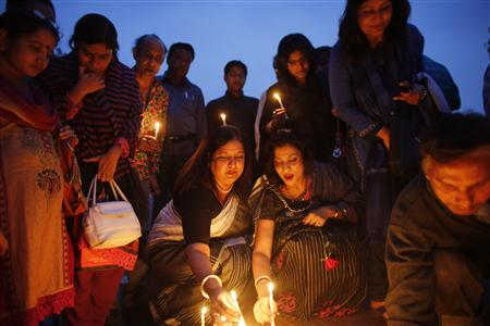 Artists and activists attend a candlelight vigil in tribute of former South Africa President Nelson Mandela, in Dhaka.