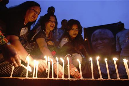 Artists and activists attend a candlelight vigil in tribute of former South Africa President Nelson Mandela, in Dhaka