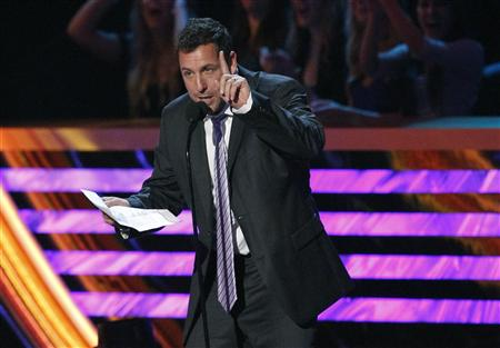 "Adam Sandler speaks after being named ""Favorite Comedic Movie Actor"" at the 2013 People's Choice Awards in Los Angeles"