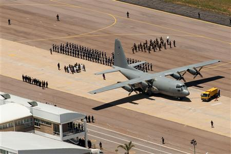 GCIS handout of the coffin carrying former South African President Nelson Mandela being prepared to be loaded onto a military plane at Waterkloof airforce base in Pretoria