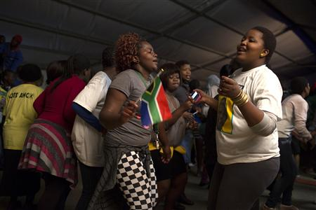 ANC supporters dance in honour of former South African President Nelson Mandela at the Walter Sisulu University in Mthatha