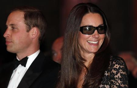 "Catherine, the Duchess of Cambridge, wears 3D glasses before a screening of ""David Attenborough's Natural History Museum Alive 3D"" with her husband Britain's Prince William at the Natural History Museum in London"