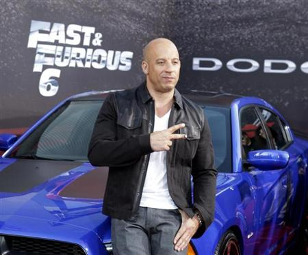 "Cast member and producer Vin Diesel poses at the premiere of the new film, ""Fast & Furious 6"" at Universal Citywalk in Los Angeles"